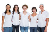 Cheerful pretty women posing with white tops — Stock Photo