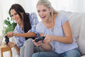 Friends playing video games and having fun — Stock Photo