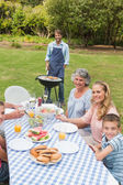 Happy extended family having a barbecue — Stock Photo