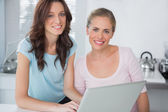 Cheerful women with laptop — Stock Photo