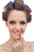 Portrait of young model with hair curlers — Stock Photo