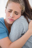 Woman taking her sad friend in her arms — Stock Photo