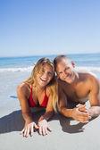 Smiling cute couple in swimsuit posing — Zdjęcie stockowe