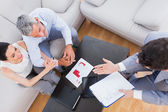 Salesman making his pitch to couple — Stock Photo