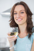 Brunette having a glass of white wine — Stock Photo