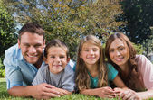 Happy family lying on the grass — Stock Photo