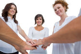 Cheerful models joining hands in a circle — Stock Photo
