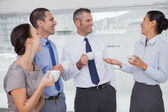 Cheerful work team during break time — Stock Photo