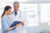 Nurse and doctor looking a file — Stock Photo
