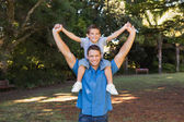 Father holding his son on shoulders — Stock Photo
