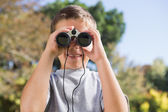 Boy looking through binoculars — Stok fotoğraf