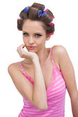 Cheeky model posing wearing hair curlers — Stock Photo