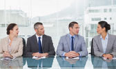 Business people sitting straight talking together — Stock Photo