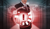 Businessman touching futuristic warning icon interface — Stock Photo