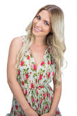 Cheerful attractive blonde wearing flowered dress posing — Stock Photo