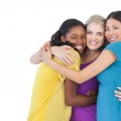 Diverse young women embracing each other — Stock Photo #29450179