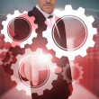 Stock Photo: Businessmselecting futuristic cog and wheel interface