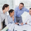 Architects anaylzing plans together — Stock Photo
