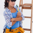 Stock Photo: Womready for home improvement