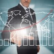 Businessman touching futuristic chart and map interface — Stock Photo