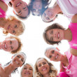 Stock Photo: Cheerful women in circle wearing pink for breast cancer