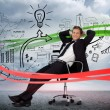 Businessman sitting in front of detailed success brainstorm — 图库照片
