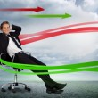 Confident businessman reclining in swivel chair with red and gre — Foto Stock