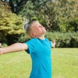 Boy stretching his arms and enjoying the sun — Stock Photo