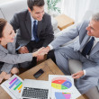 Business people shaking hands while working — Stock Photo #29451601