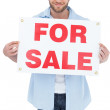 Charming young mholding for sale sign — Stock Photo #29451639