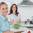 Relaxed women cooking together — Stock Photo