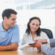 Smiling couple signing contract with real estate agent — Stock Photo #29451727