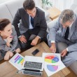 Business people analyzing diagrams together — Stock Photo #29451743