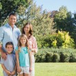 Family standing in a park — Stock Photo