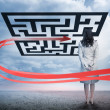 Businesswoman standing looking at red arrow through qr code — Stock Photo #29452003