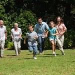Happy multi generation family running towards camera — Stock Photo