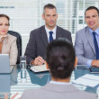 Business team listening to the applicant in interview — Stock Photo #29452519