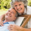 Stock Photo: Happy mature couple smiling at camera