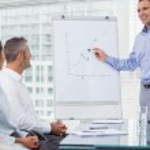 Businessman analyzing graph during presentation — Stock Photo