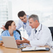 Doctors and surgeon discussing together — Stock Photo #29452817
