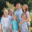 Stock Photo: Happy family and grandparents in the countryside