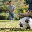 Child running for the football — Stock Photo