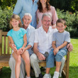 Happy multi generation family sitting in the park — Stock Photo