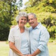 Happy mature couple smiling and looking at camera — Stock Photo