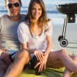 Smiling couple posing while having barbecue — Foto de Stock