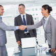 Cheerful business people meeting and shaking hands — Stock Photo