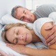 Couple sleeping and spooning in bed — Stock Photo