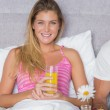 Happy young woman having breakfast in bed with partner — Stock Photo #29453855