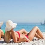 Attractive women in bikinis tanning — Stock Photo #29454335