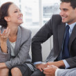 Businesswoman smiling while her partners looking at her — Stock Photo #29454733